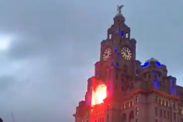 The man was arrested on suspicion of arson, as fireworks set fire to Liverpool's Liver Building, Causing'at least £ 10,000 worth of damage'